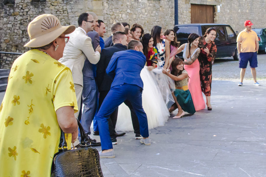 Bride and wedding party outside the church in Gijon Asturias, Spain. City Life Groom Taking Photos Wedding Adult Bride Candid Day Full Length Guests Large Group Of People Men Outdoors People Posing Real People Street Togetherness Wedding Day Wedding Dress Wedding Party White Women Yellow
