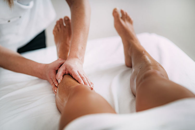 Legs Sports Massage Therapy Therapy Massage Legs Calf Foot Female Body Part Treatment Injury Muscle Care Young Physiotherapy Pain Professional Athlete Physical Woman Massaging Alternative Rehabilitation person Hands Muscular Wellbeing