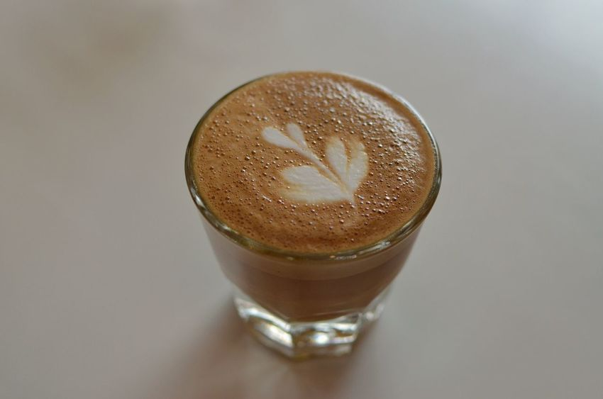 A small latte called a cortado made with espresso and steamed milk, and it has a leaf decoration. Food And Drink Still Life Coffee - Drink Hot Drink Non-alcoholic Beverage Frothy Drink Cortado Latte Coffee Relaxing Moments Japan Specialty Coffee