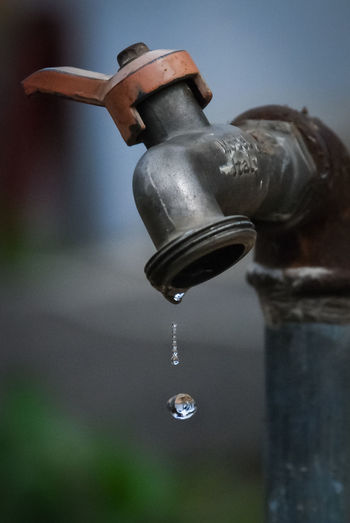 Close-up of water drop from faucet