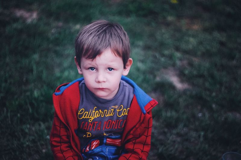 The Portraitist - 2017 EyeEm Awards Childhood Boys Innocence Looking At Camera Casual Clothing Text One Boy Only One Person Portrait Child Cute Outdoors Focus On Foreground Day Real People Hooded Shirt Children Only Close-up People Fujifilm_xseries