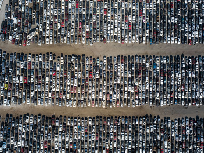 Aerial view of a scrap yard of cars Abundance Aerial View Day Architecture City High Angle View Cars Automobile Junk Junkyard Lineup Vehicle Wrecked Scrap Scrapyard Lines Used Broken Pattern Texture Background Dealership Auction Recycling Yard