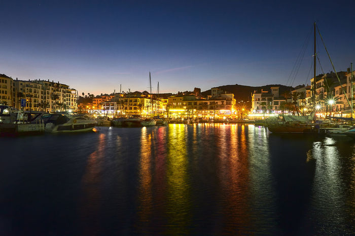 Andalucía Architecture Building Exterior City Cityscape Community Connection Development Duquesa España Human Settlement Lake Mid Distance Nautical Vessel Outdoors Reflection Residential District Rippled River Riverbank Standing Water Water Waterfront