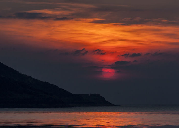 Sunset over Brean Down Brean Down Weston-super-mare Beach Beauty In Nature Bristol Channel Cloud - Sky Dramatic Sky Fort Horizon Over Water Idyllic Nature No People Orange Color Outdoors Romantic Sky Scenics - Nature Sea Sky Sunset Tranquil Scene Tranquility Water