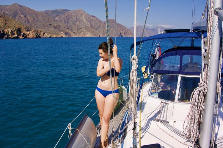 Bikini Babe. Every boat needs one. Woman Anchoring Beautiful Woman Beauty Bikini Clothing Cruising Life Day Leisure Activity Lifestyles Liveaboard Nature Nautical Vessel One Person Outdoors Real People Sailboat Sea Swimwear Transportation Water Women Yacht Young Adult Young Women