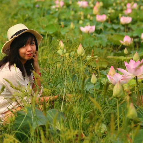 Lost with the lotus Traveler Tourist Tourism Fashion Fresh Joy ASIA Siemreap Cambodia Lotus Field Lotus Flowers Tourist Attraction  One Person Young Women Nature Girl In Nature Happiness Smiling At The Camera Tourist Attraction  Asian Girl Filipina Beauty Head Gear Contentment One With Nature Smile