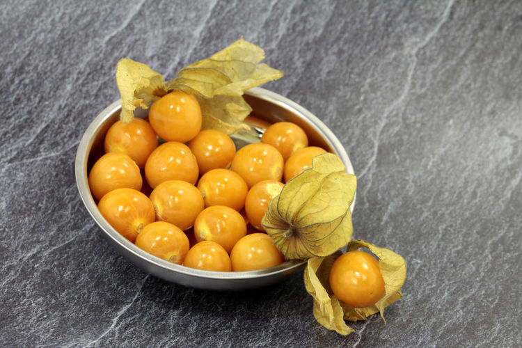 Cape Gooseberry Physalis Physalis Fruit Bubble Cherries Marbledstone Modern Art Food Food And Drink Healthy Eating Fruit Freshness Wellbeing Indoors  Close-up Yellow Citrus Fruit No People Bowl High Angle View Still Life Vegetable Orange Color Directly Above Studio Shot Group Of Objects Leaf Sweetcorn