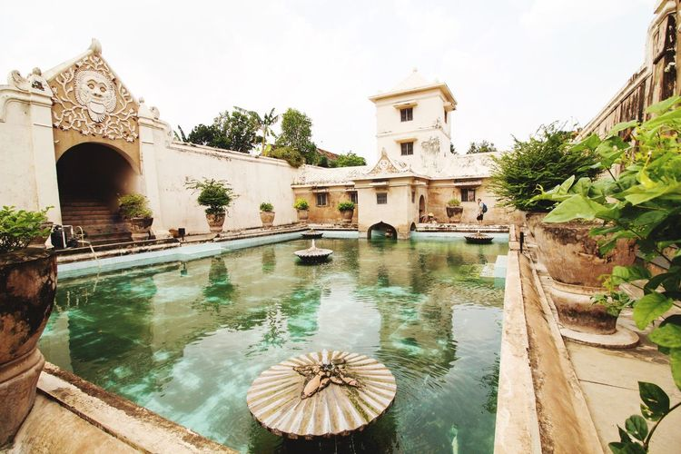 Water Architecture Built Structure Building Exterior Day Outdoors Swimming Pool Tourist Destination ASIA Tree Nature Sky Water Castle Taman Sari Sultanate Taman Sari - Yogyakarta Fountain