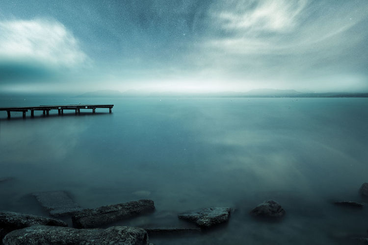 Beauty In Nature Built Structure Cloud - Sky Horizon Horizon Over Water Idyllic Long Exposure Nature No People Non-urban Scene Outdoors Rock Rock - Object Scenics - Nature Sea Sky Solid Star - Space Stars Tranquil Scene Tranquility Water