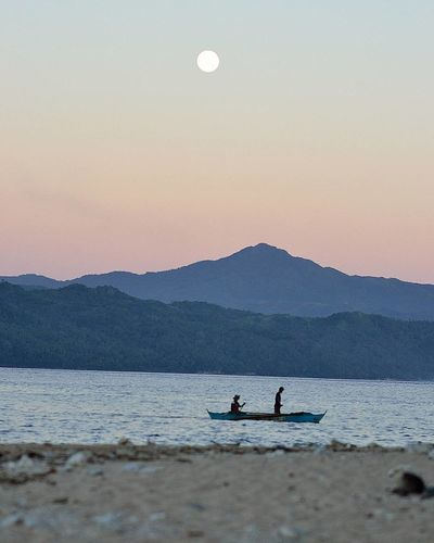 Beach Beauty In Nature Boat Idyllic Justgoshoot Leisure Activity Lensculture Lifestyles Moon Mountain Mountain Range Nature Non-urban Scene Outdoors Remote Scenics Shore Sky Sunset Tourism Tranquil Scene Tranquility Unrecognizable Person Vacations Water