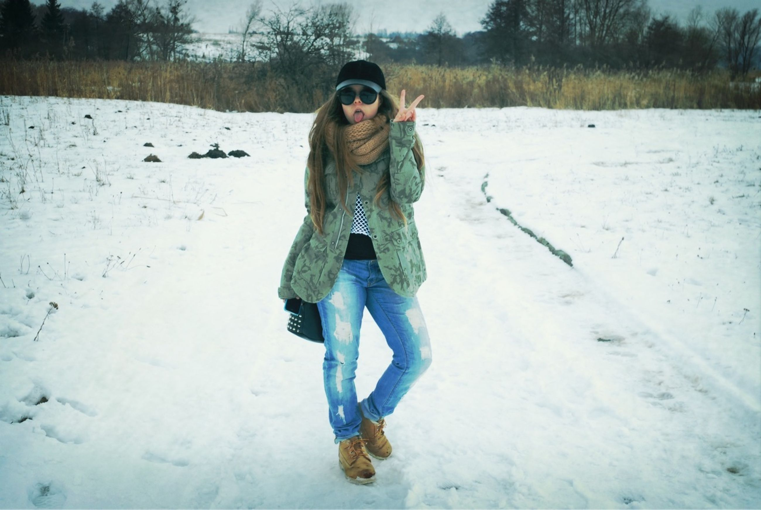 snow, winter, person, looking at camera, cold temperature, portrait, full length, young adult, lifestyles, front view, season, leisure activity, casual clothing, smiling, warm clothing, happiness, young women, standing