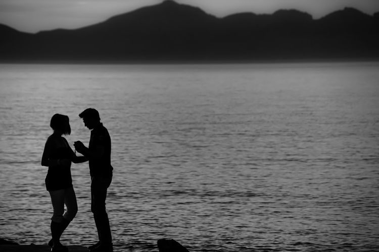 Silhouetted view of couple at beach