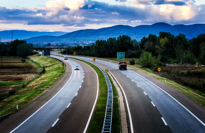 Open highway through pastoral landscape with light traffic Asphalt Autobahn Cloud - Sky Day Highway Motorway Nature No People Outdoors Road Scenics Sky The Way Forward Transportation