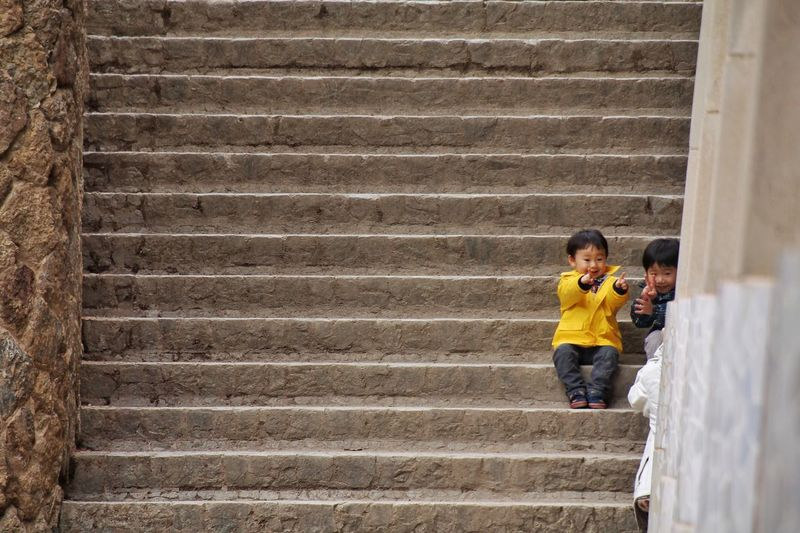 The Street Photographer - 2016 EyeEm Awards Japan Boy Children Stairs Funny Brothers Barcelona, Spain Parc Guell Yellow Cloths Feel The Journey Colour Of Life Paint The Town Yellow