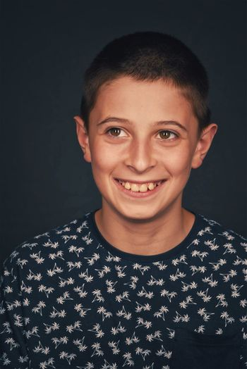 Veri Ricordi 2018 Black Background Casual Clothing Child Cut Out Emotion Front View Happiness Headshot Indoors  Leisure Activity Lifestyles Looking At Camera Males  One Person Portrait Real People Smiling Studio Shot Teenager The Portraitist - 2018 EyeEm Awards