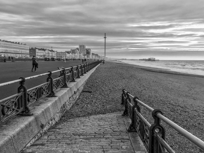 Beach combin Black And White Eyeem Collec Sky Water Cloud - Sky Sea Land Beach Real People Nature Day Railing Men Incidental People Walking Lifestyles The Way Forward Direction Horizon Beauty In Nature Tranquility Horizon Over Water