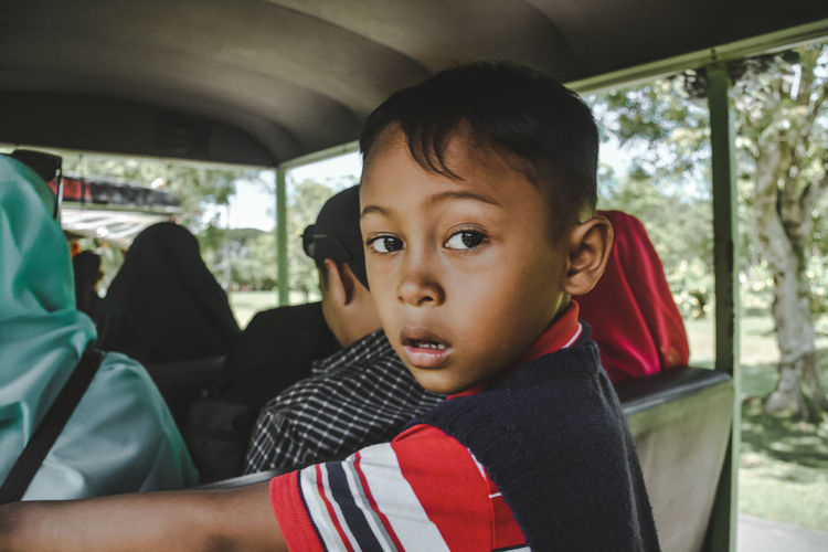 The Art Of Street Photography Child Portrait Childhood Looking At Camera Headshot Car Interior City Journey Front View Close-up Back Seat Road Trip Passenger Seat Convertible Moving My Best Photo