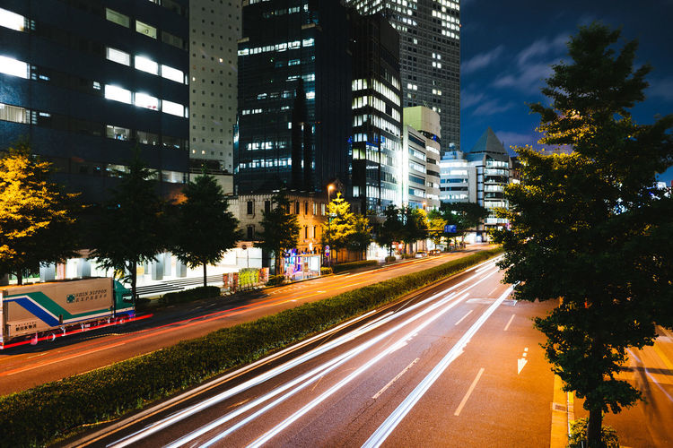 Light trails in Shinjuku, Tokyo. Architecture Building Built Structure City City Life City Street Cityscape Day Diminishing Perspective Growth Illuminated Light Trail Long Exposure Modern Night No People Office Building Outdoors Road Sky Tall - High The Way Forward Traffic Tree Urban