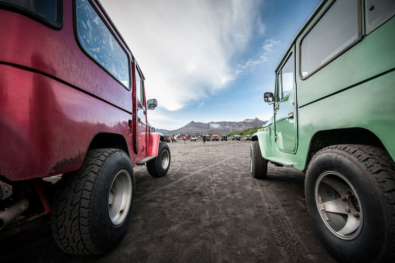 Off-Road Vehicles On Road Against Sky