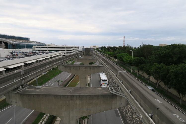 High angle view of highway in city against sky