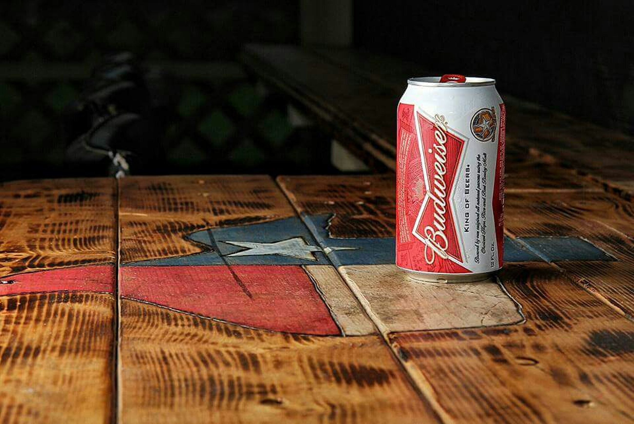 text, western script, red, communication, indoors, paper, table, flag, still life, patriotism, identity, wood - material, close-up, no people, information, non-western script, selective focus, book, heart shape, day