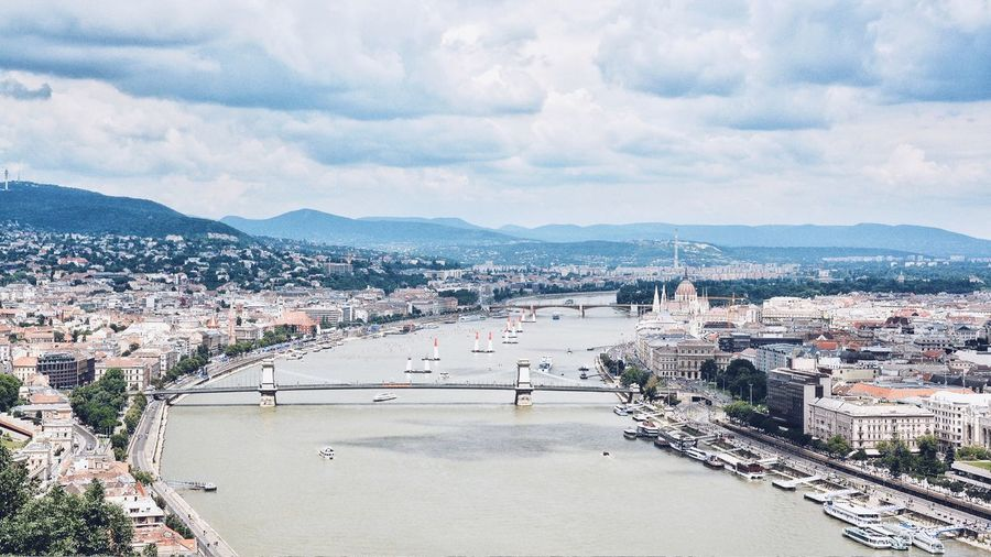 High angle view of danube river amidst buildings against sky