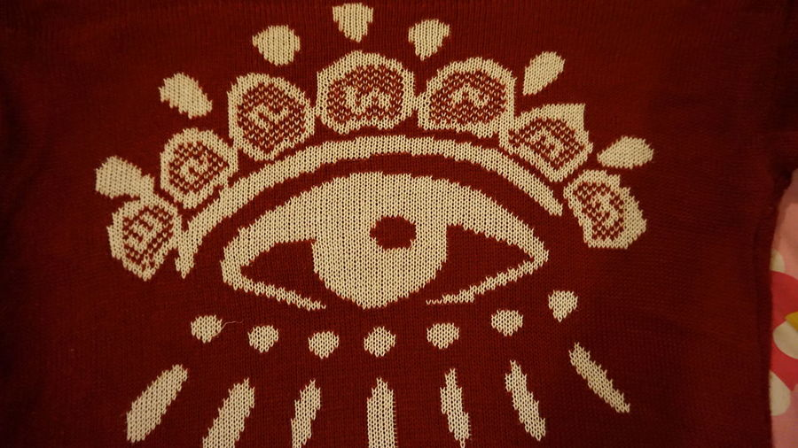 Textile Close-up Pattern Indoors  Creativity Red Art And Craft No People Design Communication Text Wool Clothing Representation Western Script Animal Representation Mammal Animal Animal Themes Carpet - Decor Floral Pattern Embroidery