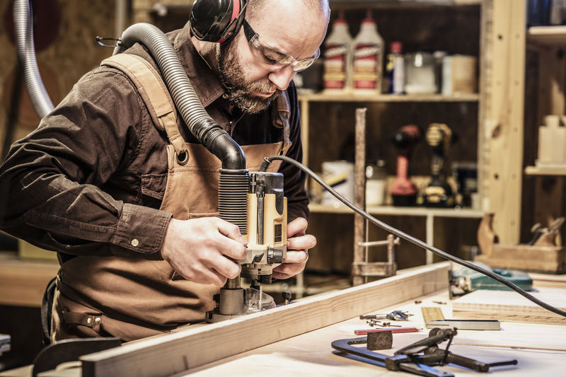 Man working on wood at workshop