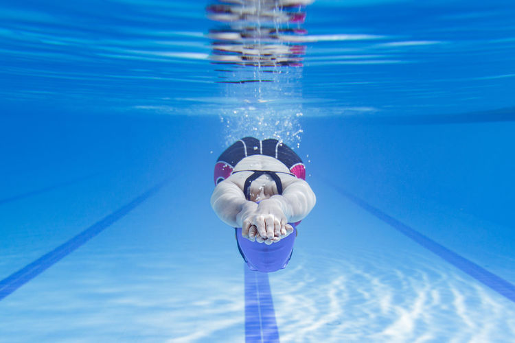 Adult Blue Body Part Day Front View Holding Human Arm Human Limb Nature Obscured Face One Person Outdoors Pool Reflection Sea Swimming Swimming Pool Underwater Waist Up Water Young Adult