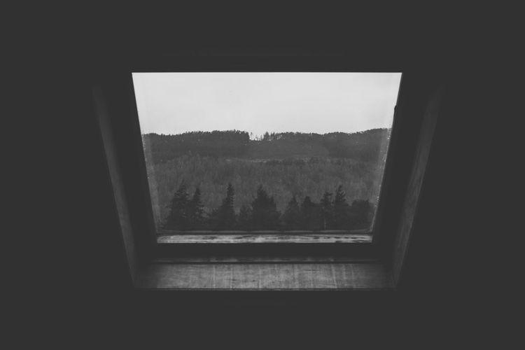 Landscape seen through window of house