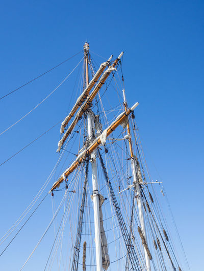 Wooden sailing ship pole isolated on blue sky background. Nautical Vessel Sky Sailboat Ship Mast Pole Blue Low Angle View Mode Of Transportation Sailing Transportation Sailing Ship Rope Clear Sky Nature Day Sea Water No People Travel Rigging Outdoors Passenger Craft Yacht Australia