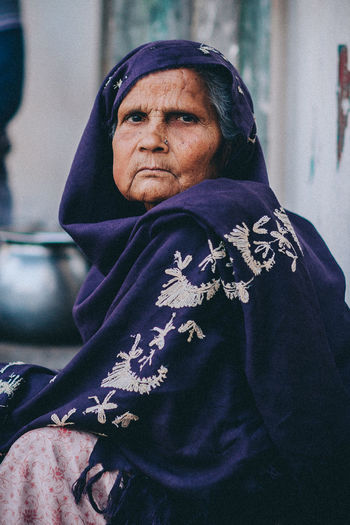 Portrait A Close-up INI Lifestyles One Person Outdoors People Photography Portrait Portrait Of A Woman Portrait Photography Real People Senior Adult Senior Women Street Streetsofindia Traditional Clothing Women