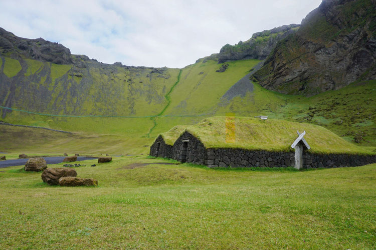 Idyllic Iceland Cliff Green Roof Green Roofed Hut Viking Viking House Mountain Rural Scene Agriculture Sky Landscape Grass Green Color Civilization Hut Ancient Old Ruin Growing Valley