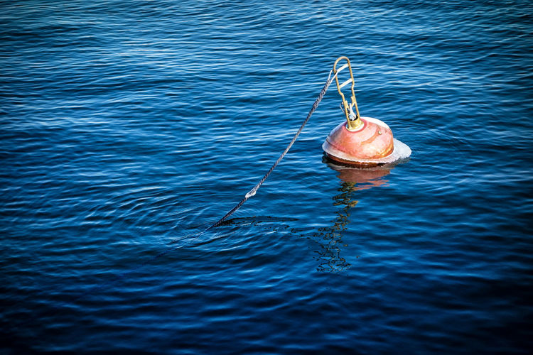 High angle view of buoy in sea