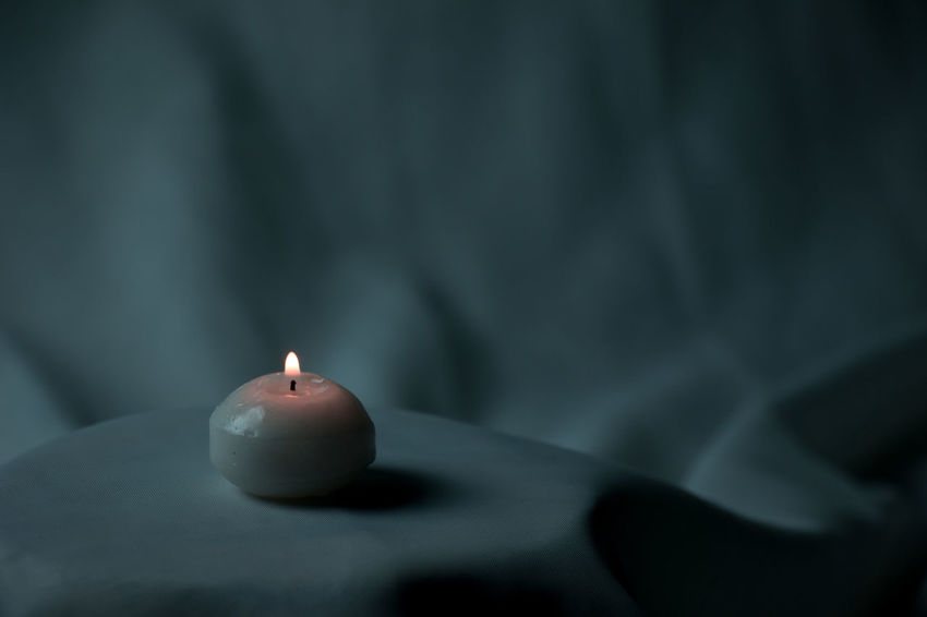 Low light candle minimalism Burning Candle Close-up Day Flame Heat - Temperature Illuminated Indoors  No People