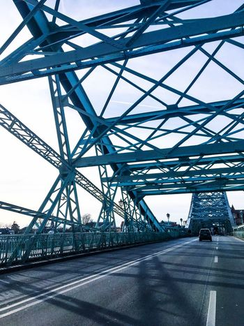 The blue wonder bridge in dresden/germany. Blue Building Exterior History Through The Lens  Structures & Lines Streetphotography Out Of Car Window Blue Metal Bridge Out Of Car Iphonephotography Blue Wonder Bridge Dresden Bridge - Man Made Structure Connection Built Structure Transportation Architecture Metal Road City No People Sky Travel EyeEmNewHere AI Now EyeEm Ready   EyeEmNewHere An Eye For Travel Press For Progress Stories From The City