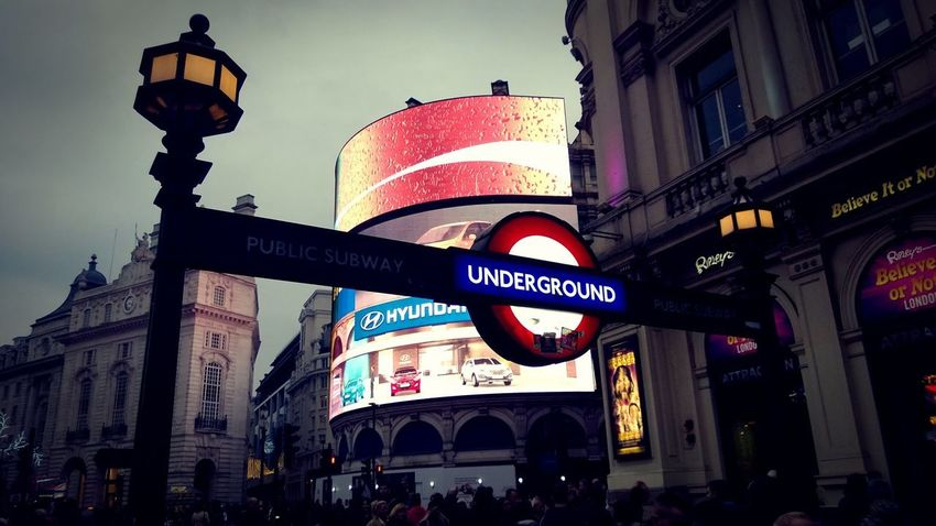 picadilly madness Photowalktheworld City Politics And Government Riot Illuminated Communication City Life Architecture Building Exterior Sky Built Structure Information Neon Neon Colored Commercial Sign Sign Billboard Advertisement Signboard Board