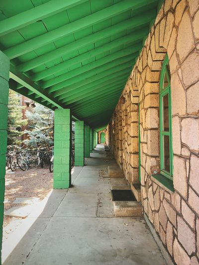 """To The Green Door"" A long walk to the end of the rooms and a green door at the historic Motel Sierra Vista on historic Route 66 in Flagstaff, Arizona. Of interest, this motel offer ""Inclosed Steam Heated Garages."" Route 66 historic Historical Building stone historic motel historic Motels Hallway Architecture built structure direction the way forward no people Green color day wall - building feature diminishing perspective buildin Route 66 Historic Historical Building Stone Historic Motel Historic Motels Hallway Architecture Built Structure Direction The Way Forward No People Green Color Day Wall - Building Feature Diminishing Perspective Building"