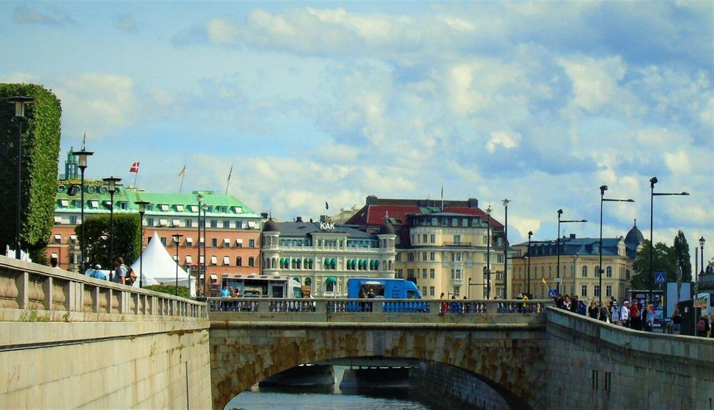 Cloud - Sky Architecture Bridge - Man Made Structure Water Built Structure Sky City Day Building Exterior Outdoors Travel Destinations River No People Sweden Sweden Trippin' City Vacations Travel Tourism Architecture Water Your Ticket To Europe EyeEmNewHere