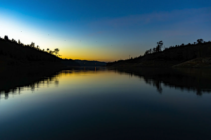 Aldeia do mato Tourism Visiting Weekend Photography River Landscape_Collection Nikon Reflection Lake Sunset Water Silhouette Scenics Nature Sky Dusk Outdoors Beauty In Nature Landscape Tranquil Scene No People Tranquility Travel Destinations Fog Silence Mountain Horizon Over Water