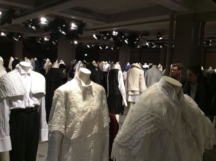 London Business Clothing Crowd Fashion Group Of People Hanging Human Representation Illuminated Indoors  Large Group Of People Mannequin Men Real People Rear View Retail  Retail Display Shopping Store Women