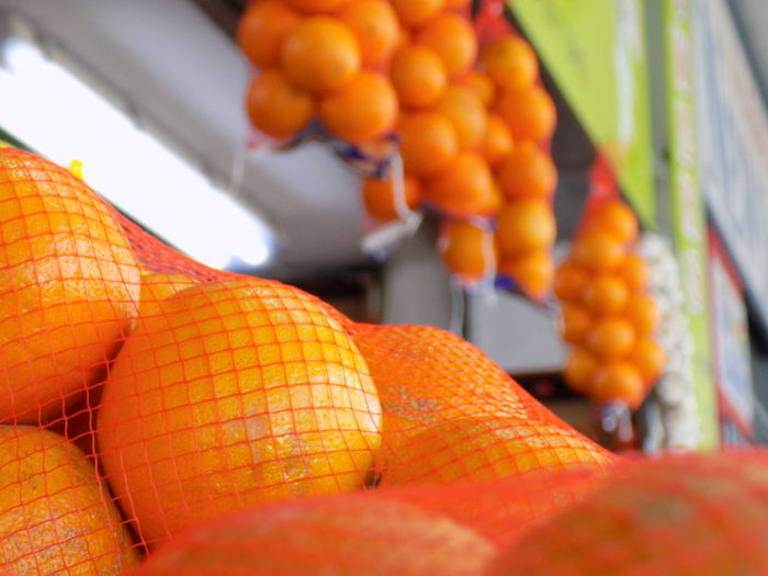 Close-up of orange fruits for sale at market stall