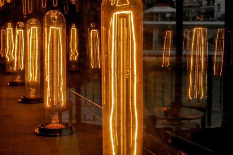 Close-up of illuminated electric lamp at night