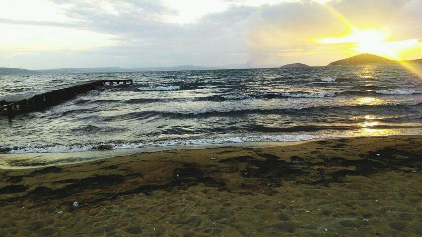 Erdek 💜 Where There Is Light, There Is Love. Followme Whereisthesun Nature Sky Beach Sunset Sea Cloud - Sky Beauty In Nature No People Scenics Sunbeam Water Sunlight Outdoors Wave Sun Dramatic Sky Sand Day
