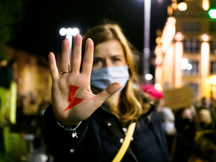 Woman has drawn a sign lightning on hand. women protest against tightening of abortion law. poland.