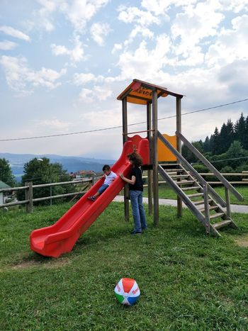 Playground Outdoor Play Equipment Sky Jungle Gym Childhood Park - Man Made Space Grass Red Day Outdoors No People Soccer Field Tramonto Panorama Paesaggio Beauty In Nature Nature Freshness Kids Playing Child Family Time Happiness Relazione Mountain