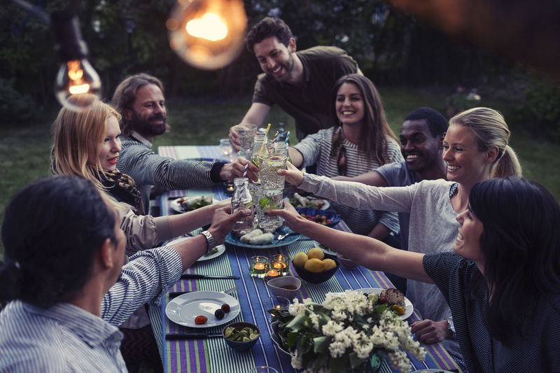 Group of people in drinking glasses on table