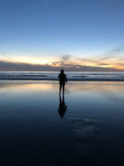 #EyeEmNewHere Water One Person Silhouette Beauty In Nature Reflection Sunset Beach EyeEmNewHere California Dreamin
