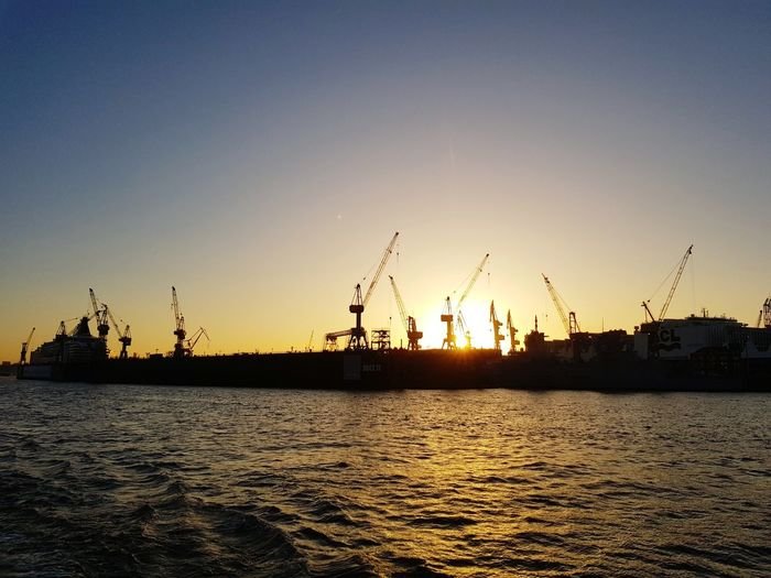 Sunset Business Finance And Industry Silhouette Sea Fuel And Power Generation Water Outdoors No People Nautical Vessel Nature Dusk Industry Travel Destinations Technology Oil Industry Harbor Sustainable Resources Social Issues Sky Tranquility Hamburg Hamburger Hamburg Harbour Hamburger Hafen