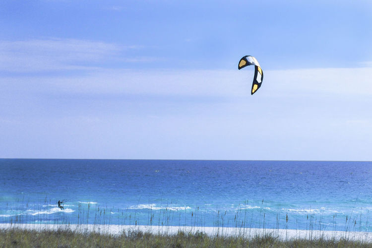 Gaining speed Adventure Beach Beauty In Nature Cloud - Sky Day Extreme Sports Horizon Over Water Kiteboarding Nature One Person Outdoors Parachute Parasailing Real People Scenics Sea Sky Tranquility Water
